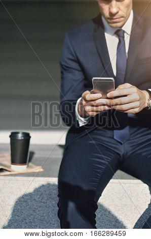 Working With Smartphone Man Wearing Stylish Suit