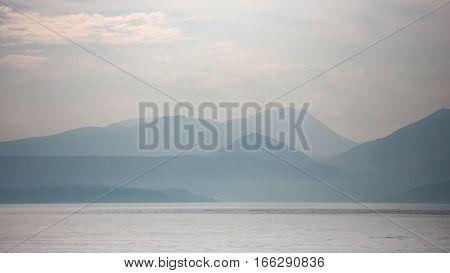 A dusky view of the Italian Alps over Lake Garda Italy.