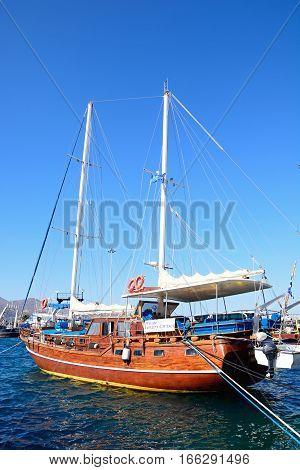 AGIOS NIKOLAOS, CRETE - SEPTEMBER 17, 2016 - Large wooden yacht in the harbour Agios Nikolaos Crete Greece Europe, September 17, 2016.
