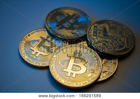 Golden Bitcoins On Blue Background. Trading Concept Of Crypto Currency