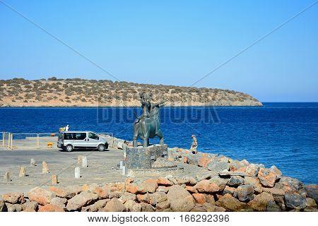 AGIOS NIKOLAOS, CRETE - SEPTEMBER 17, 2016 - Statue of Europe sitting on a bull at the waters edge Agios Nikolaos Crete Greece Europe, September 17, 2016.