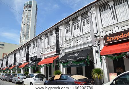 Komtar Tower From One Of The Street In Penang