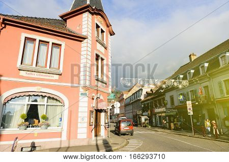 THANN FRANCE - DEC 12 2015: Famille Seltz - typical Alsatian restaurant on a calm morning in the city of Thann - located on the Rue du 7 Aout it is a renomed traditional Alsatian restaurant