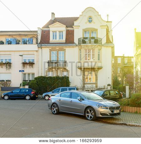 STRASBOURG FRANCE - DEC 25 2016: typical french street with peugeot car parked in frontof the timbered house in strasbourg france
