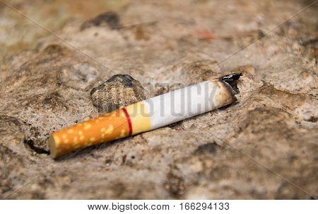 Close up cigarette stub in public dumping ground