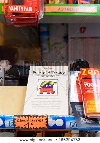 PARIS FRANCE - JAN 21 2017: Pourquoi Trump - translates as Why Trump - pocket book at newsstand depicting the realities of America and why it was elected as an American President