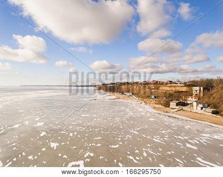 Beautiful frozen sea. Winter landscape in beach. Aerial view.