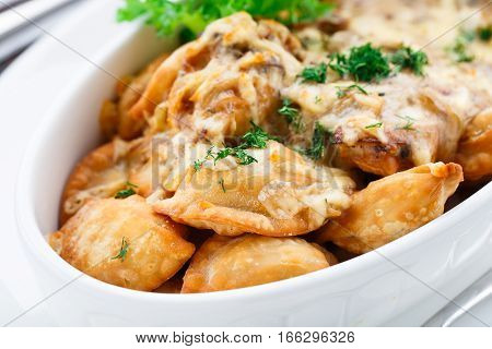 Delicious dumplings with mushroom sauce in a bowl