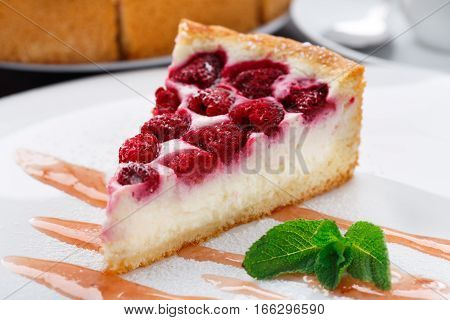 Delicious cheesecake with raspberries on a plate