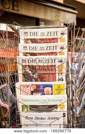 PARIS FRANCE - JAN 21 2017: Die Zeit Bild Suddeutsche Zeitung Neue Burcher Zeitung Taz am wochenende German newspaper from a newsstand featuring headlines with Donald Trump inauguration as the 45th President of the United States in Washington D.C