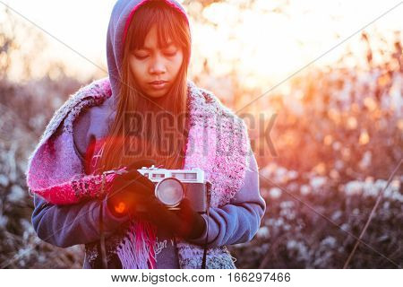 Female photographer in cold weather with natural sun flare