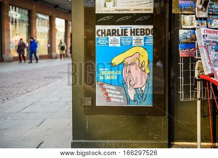 PARIS FRANCE - JAN 21 2017: French press newsstand featuring headlines with Donald Trump inauguration as the 45th President of the United States in Washington D.C as a comic satire on Charlie Hebdo cover
