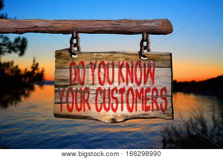 Do you know your customers motivational phrase sign on old wood with blurred background