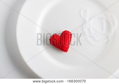 Red Heart On A White Plate. Concept. Valentine, Beautiful Background
