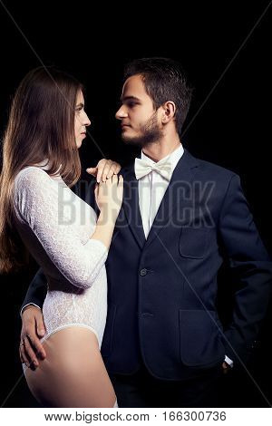 Hot Woman In Sexy Body Lingerie Next To Man In Suit
