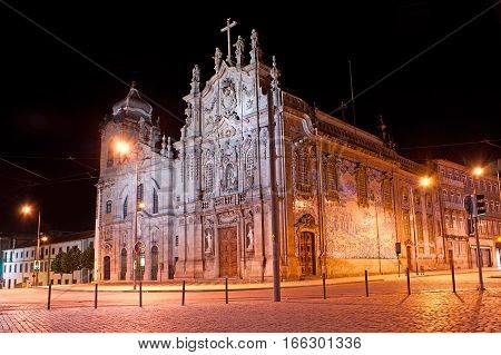The Carmo and Carmelite Churches decorated with azulejos sculptures and carved patterns in bright evening lights Porto Portugal.