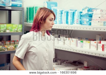 Doctor In The Warehouse Looking At Products