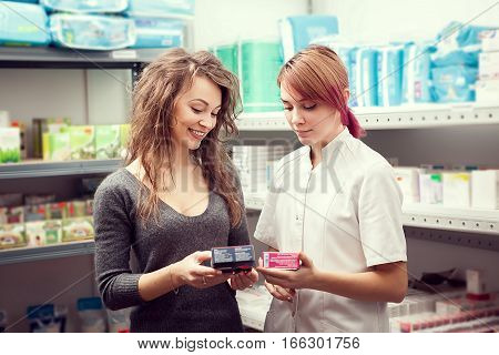 Pharmacist And Client In The Warehouse