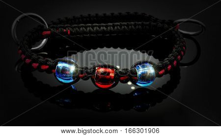 The collar on the dog - Paracord and beads - Black background