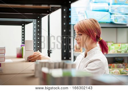 Young Female Doctor In The Warehouse