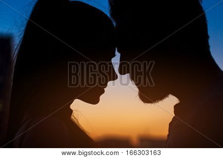 Couple face silhouette. Woman, man and evening sky. Two hearts one life.