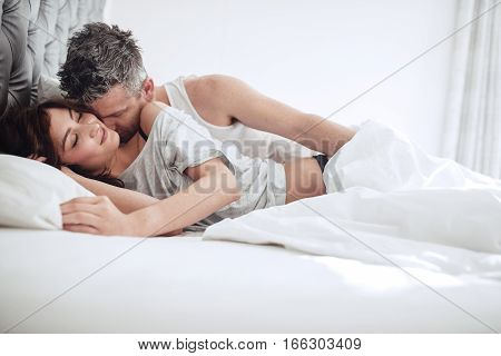 Intimate Young Couple On Bed