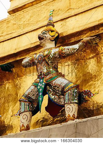 Guardian deity on the walls of kings palace, Bangkok, Thailand