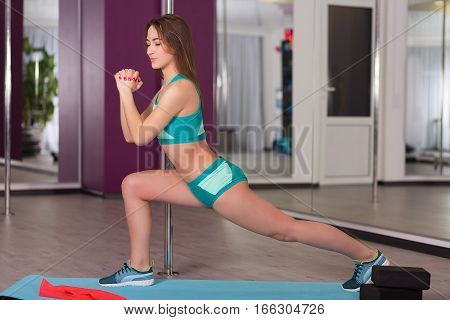 Young Woman In The Fitness Studio