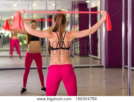 Beautiful Woman Working Out At The Fitness Studio