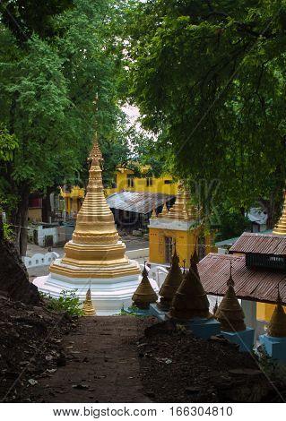 GOLDEN STUPA BUILT IN MONASTERY, MANDALAY, MYANMAR