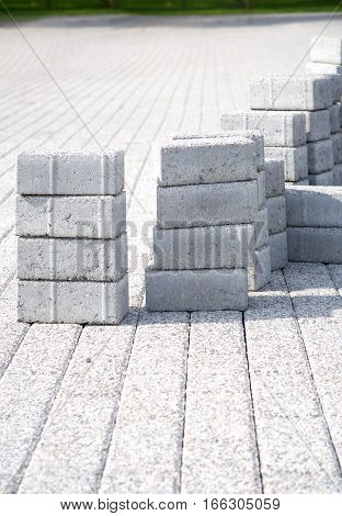 Laying paving slabs of gray in the town's pedestrian zone. Vertical photo