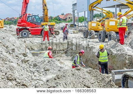 Zrenjanin Vojvodina Serbia - May 29 2015: Assembly process concrete reinforcement housing for drainage waste water from resident sanitary sewer system