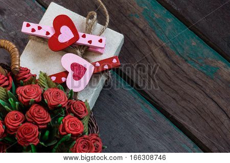 Heart on a gift box with a red rose.