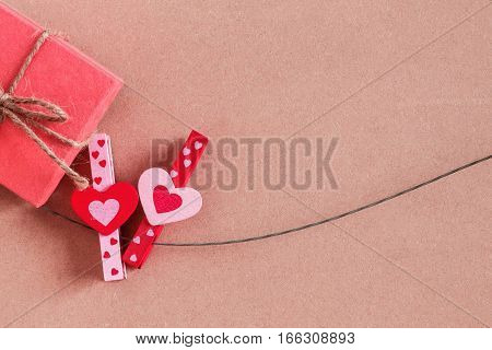 Heart-shaped pin and gift boxes on the wire.
