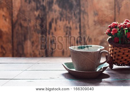 cup of coffee on the old wooden table.
