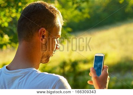 Attractive Young Adult Use Smartphone