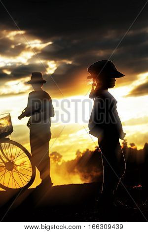 The girl and father at a sunset.