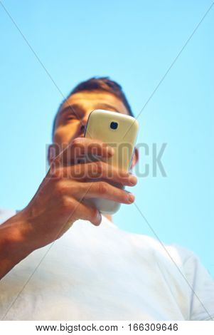 Beautiful Young Man Have Fun Using Social Networks With Smartphone