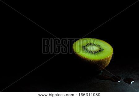 Side of kiwi with moody and dark style and background