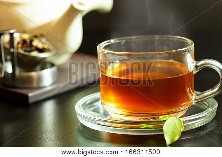 Tea beverage in tea cup on background