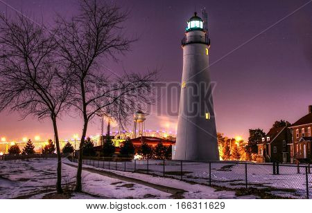 Michigan's Oldest Lighthouse. The Fort Gratiot Lighthouse in downtown Port Huron, Michigan illuminated at night.