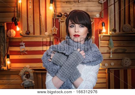 beautiful young woman with grey knitted scarf in the Studio.