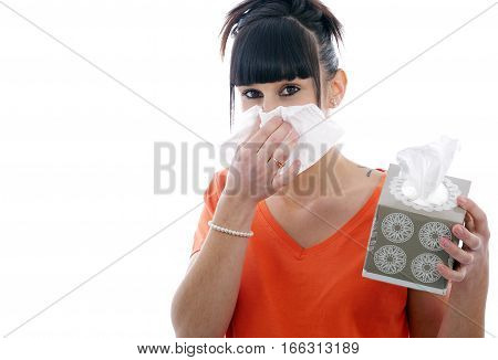 sick young brunette woman blowing her nose isolated on white background