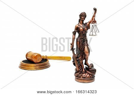 statue of justice and judges gavel on a white background. horizontal photo.
