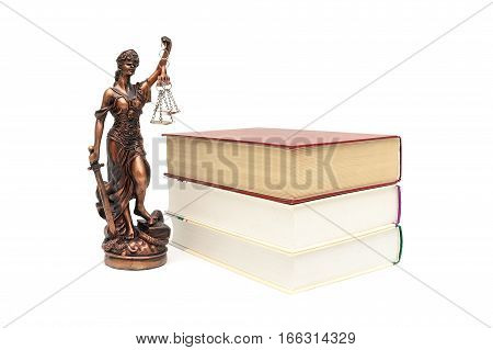 statue of justice and books on white background. horizontal photo.