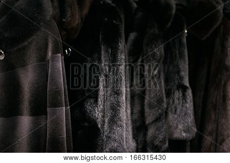 Fur Coats Hanging On Hangers In The Boutique