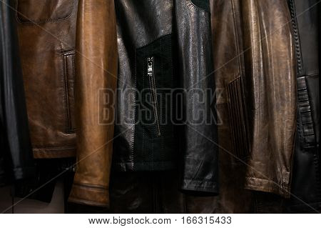 Leather Coats Hanging On Hangers In The Boutique