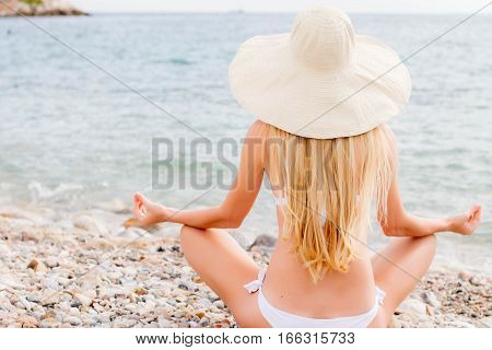 Woman with beautiful body at tropical beach.