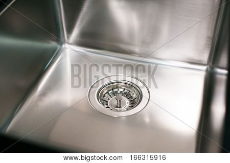Angle View Of Kitchen Sink With Gold Faucet