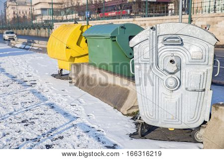 Trashcans of the city at cold winter